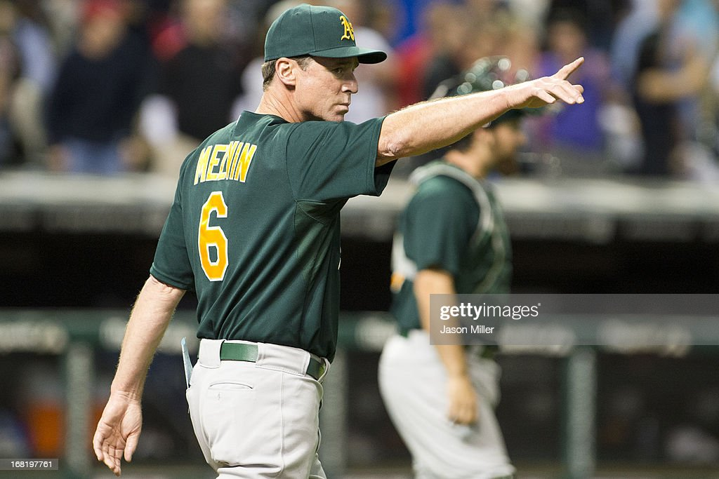 Manager <a gi-track='captionPersonalityLinkClicked' href=/galleries/search?phrase=Bob+Melvin&family=editorial&specificpeople=239192 ng-click='$event.stopPropagation()'>Bob Melvin</a> #6 of the Oakland Athletics signals to the bullpen during a pitching change during the seventh inning against the Cleveland Indians at Progressive Field on May 6, 2013 in Cleveland, Ohio.
