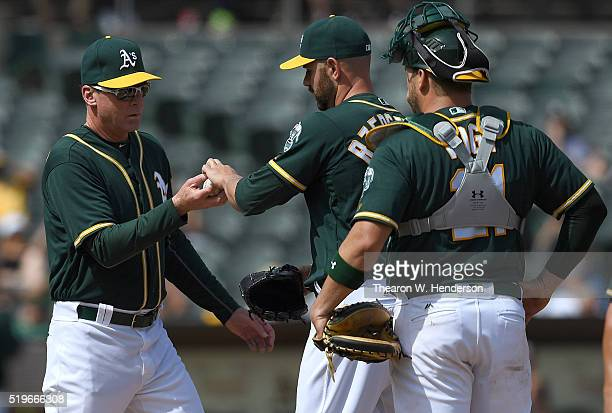 Manager Bob Melvin of the Oakland Athletics take the ball from pitcher Marc Rzepczynski taking him out of the game against the Chicago White Sox in...