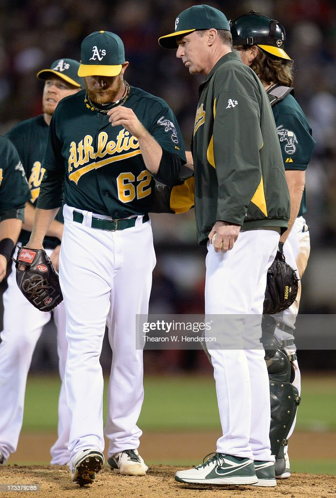 Manager Bob Melvin #6 of the Oakland Athletics takes pitcher Sean Doolittle #62 out of the game in the eighth inning aginst the Boston Red Sox at O.co Coliseum on July 12, 2013 in Oakland, California.
