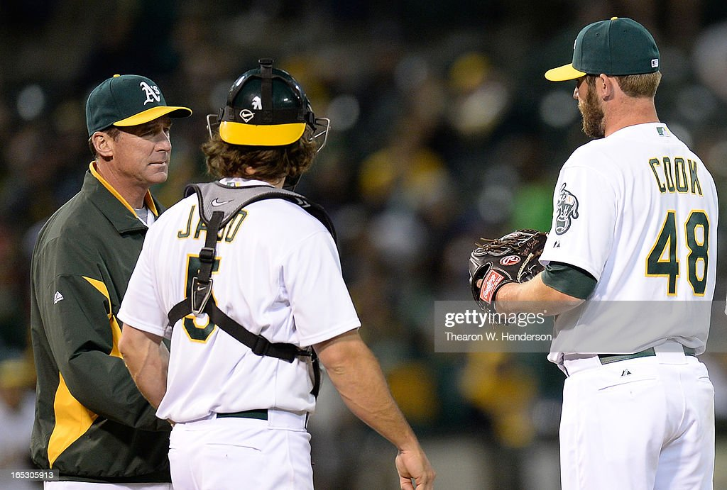 Manager <a gi-track='captionPersonalityLinkClicked' href=/galleries/search?phrase=Bob+Melvin&family=editorial&specificpeople=239192 ng-click='$event.stopPropagation()'>Bob Melvin</a> #6 of the Oakland Athletics takes Ryan Cook #48 out of the game after Cook walked in a run with the bases loaded against the Seattle Mariners in the seventh inning at O.co Coliseum on April 2, 2013 in Oakland, California.