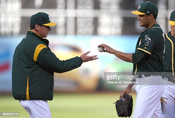 Manager Bob Melvin of the Oakland Athletics takes the ball from starting pitcher Sean Manaea taking Manaea out of the game against the Baltimore...