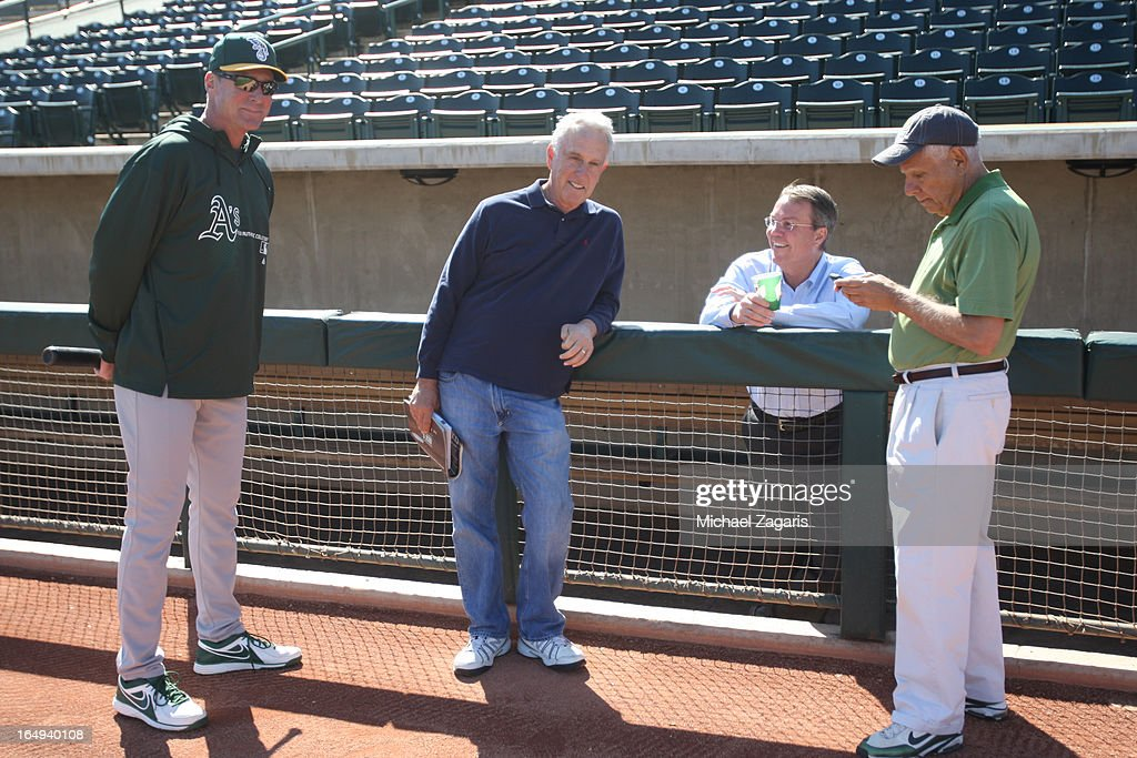 Manager <a gi-track='captionPersonalityLinkClicked' href=/galleries/search?phrase=Bob+Melvin&family=editorial&specificpeople=239192 ng-click='$event.stopPropagation()'>Bob Melvin</a> #6 of the Oakland Athletics talks with Broadcaster Ken Korach, President Michael Crowley and Owner Lew Wolff during a spring training workout at Phoenix Municipal Stadium on February 28, 2013 in Phoenix, Arizona.