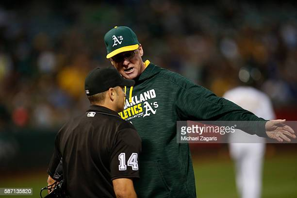 Manager Bob Melvin the Oakland Athletics argue with Umpire Mark Wegner during the game against the Toronto Blue Jays at the Oakland Coliseum on July...