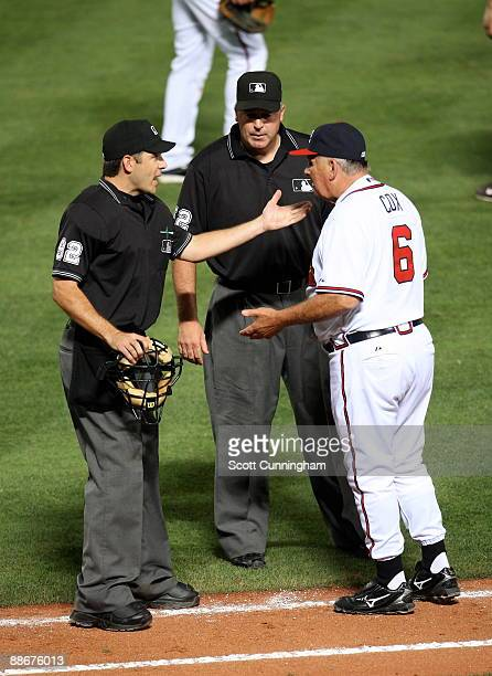 Manager Bobby Cox of the Atlanta Braves disputes a call with umpires James Hoye and Bill Welke during the game against the New York Yankees at Turner...