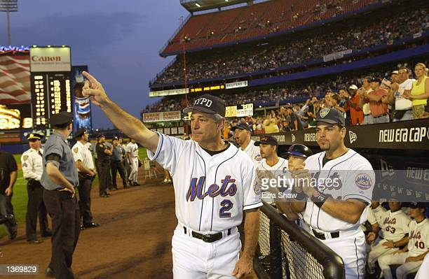 Manager Bobby Valentine and catcher Mike Piazza of the New York Mets applaude in honor of New York City Mayor Rudy Giuliani before the Mets game...