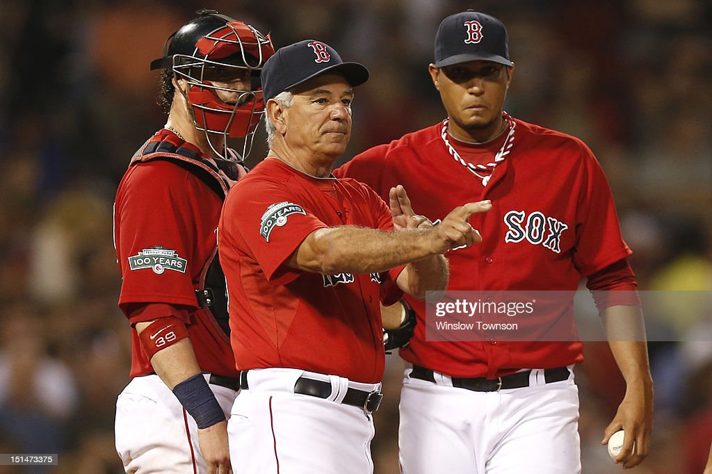 Manager <a gi-track='captionPersonalityLinkClicked' href=/galleries/search?phrase=Bobby+Valentine&family=editorial&specificpeople=214135 ng-click='$event.stopPropagation()'>Bobby Valentine</a> #25 of the Boston Red Sox signals to the bullpen removing pitcher Felix Doubront #61 of the Boston Red Sox, right, from the game as catcher <a gi-track='captionPersonalityLinkClicked' href=/galleries/search?phrase=Jarrod+Saltalamacchia&family=editorial&specificpeople=836404 ng-click='$event.stopPropagation()'>Jarrod Saltalamacchia</a> #39 of the Boston Red Sox looks on during the fourth inning of the game against the Toronto Blue Jays at Fenway Park on September 7, 2012 in Boston, Massachusetts.
