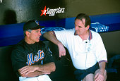 Manager Bobby Valentine of the New York Mets talks with a reporter in the dugout prior to the start of a Major League Baseball spring training game...
