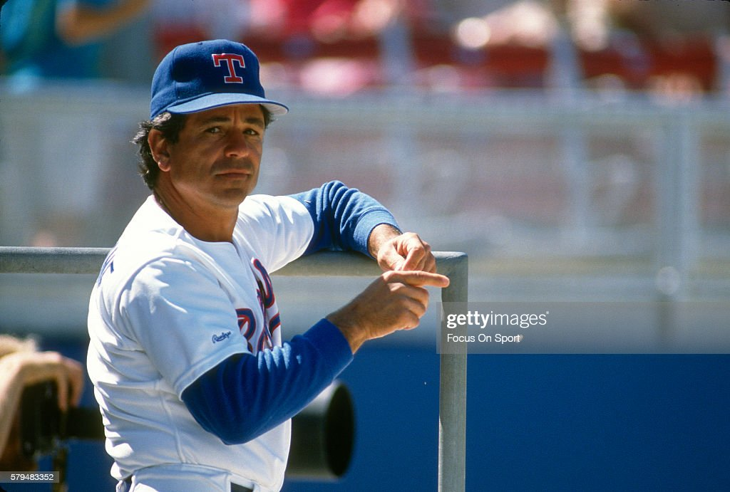 Manager Bobby Valentine of the Texas Rangers looks on from the dugout during an Major League Baseball spring training game circa 1992 at Municipal...