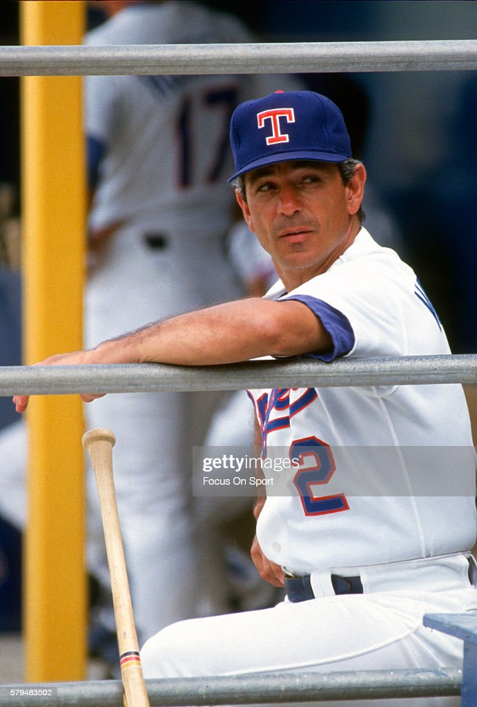 Manager Bobby Valentine of the Texas Rangers looks on from the dugout during an Major League Baseball spring training game circa 1989 at Municipal...