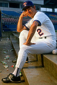 Manager Bobby Valentine of the Texas Rangers sits on the dugout steps and poses for this portrait during Major League Baseball spring training circa...