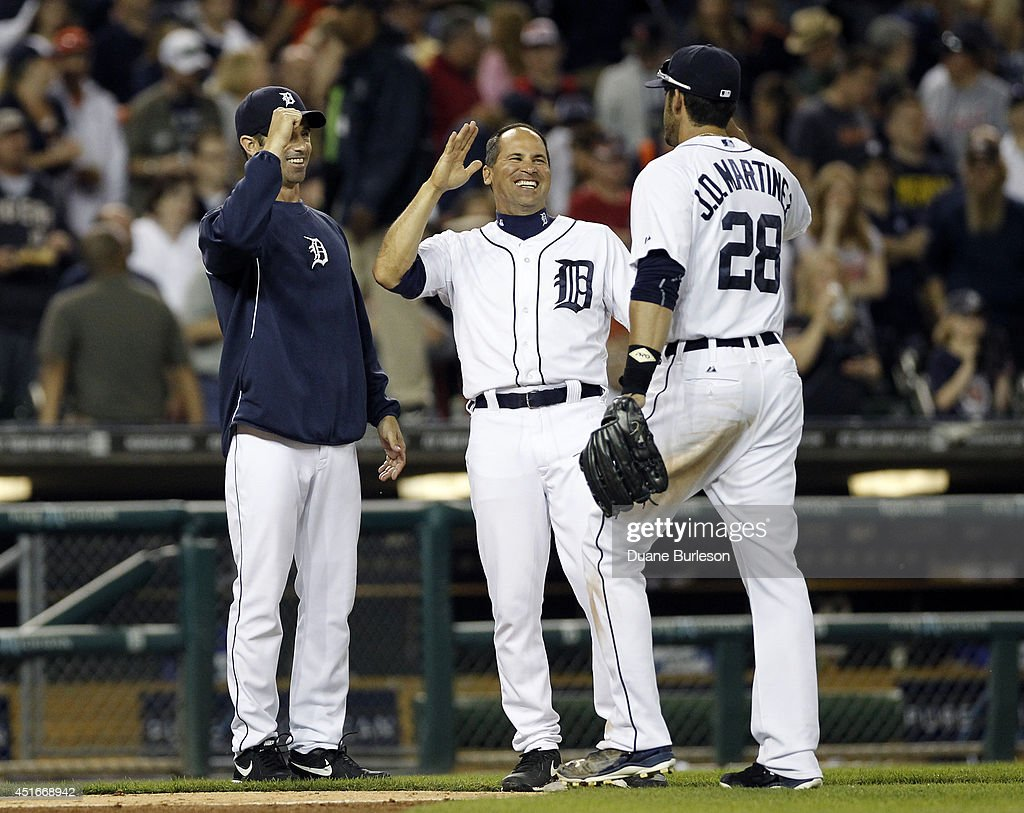 Manager <a gi-track='captionPersonalityLinkClicked' href=/galleries/search?phrase=Brad+Ausmus&family=editorial&specificpeople=209430 ng-click='$event.stopPropagation()'>Brad Ausmus</a> #7 of the Detroit Tigers and first base coach <a gi-track='captionPersonalityLinkClicked' href=/galleries/search?phrase=Omar+Vizquel&family=editorial&specificpeople=201489 ng-click='$event.stopPropagation()'>Omar Vizquel</a> #31 laugh as they celebrate a 8-1 win over the Tampa Bay Bay Rays with <a gi-track='captionPersonalityLinkClicked' href=/galleries/search?phrase=J.D.+Martinez&family=editorial&specificpeople=7520024 ng-click='$event.stopPropagation()'>J.D. Martinez</a> #28 at Comerica Park on July 3, 2014 in Detroit, Michigan.