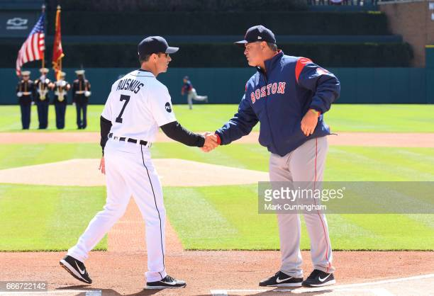 Manager Brad Ausmus of the Detroit Tigers shakes hands with Boston Red Sox manager John Farrell prior to the start of the Opening Day game at...