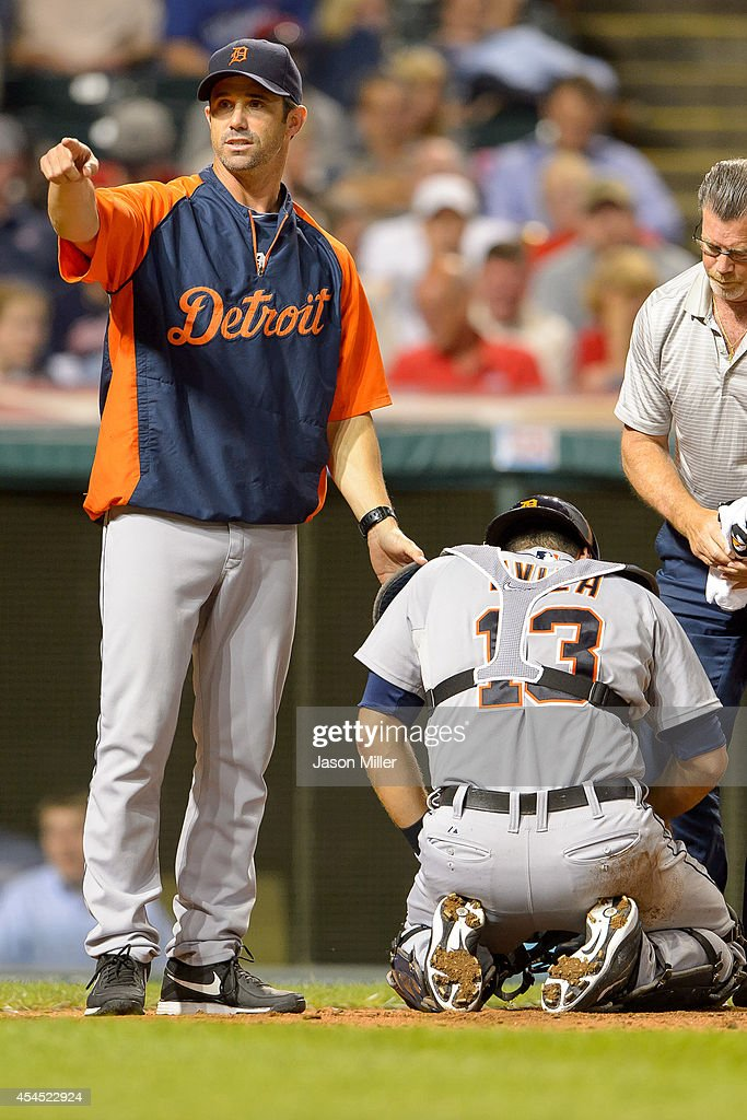 Manager Brad Ausmus #7 of the Detroit Tigers signals for a new catcher after Alex Avila #13 was hit by a foul tip during the sixth inning against the Cleveland Indians at Progressive Field on September 2, 2014 in Cleveland, Ohio.