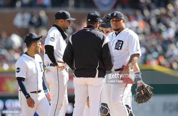 Manager Brad Ausmus of the Detroit Tigers talks with pitcher Bruce Rondon on the mound during the eight inning of the opening day game against the...