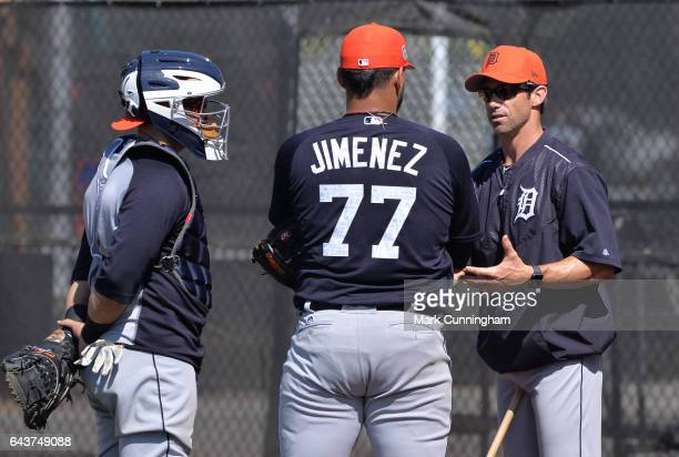 Manager Brad Ausmus of the Detroit Tigers talks with pitcher Joe Jimenez while Alex Avila looks on during Spring Training workouts at the TigerTown...