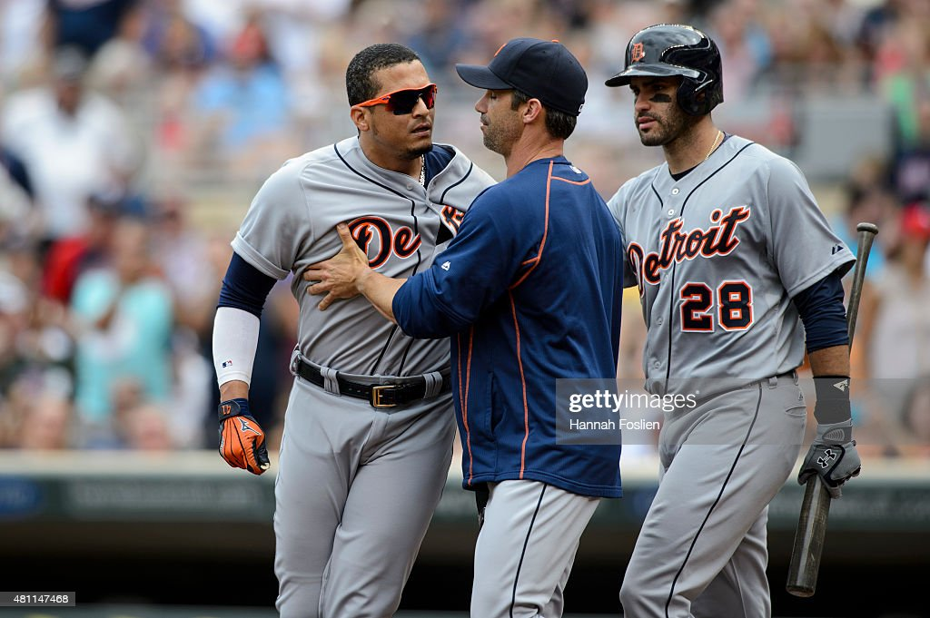 Manager Brad Ausmus of the Detroit Tigers with the help of JD Martinez hold back Victor Martinez after Martinez was ejected during the game against...