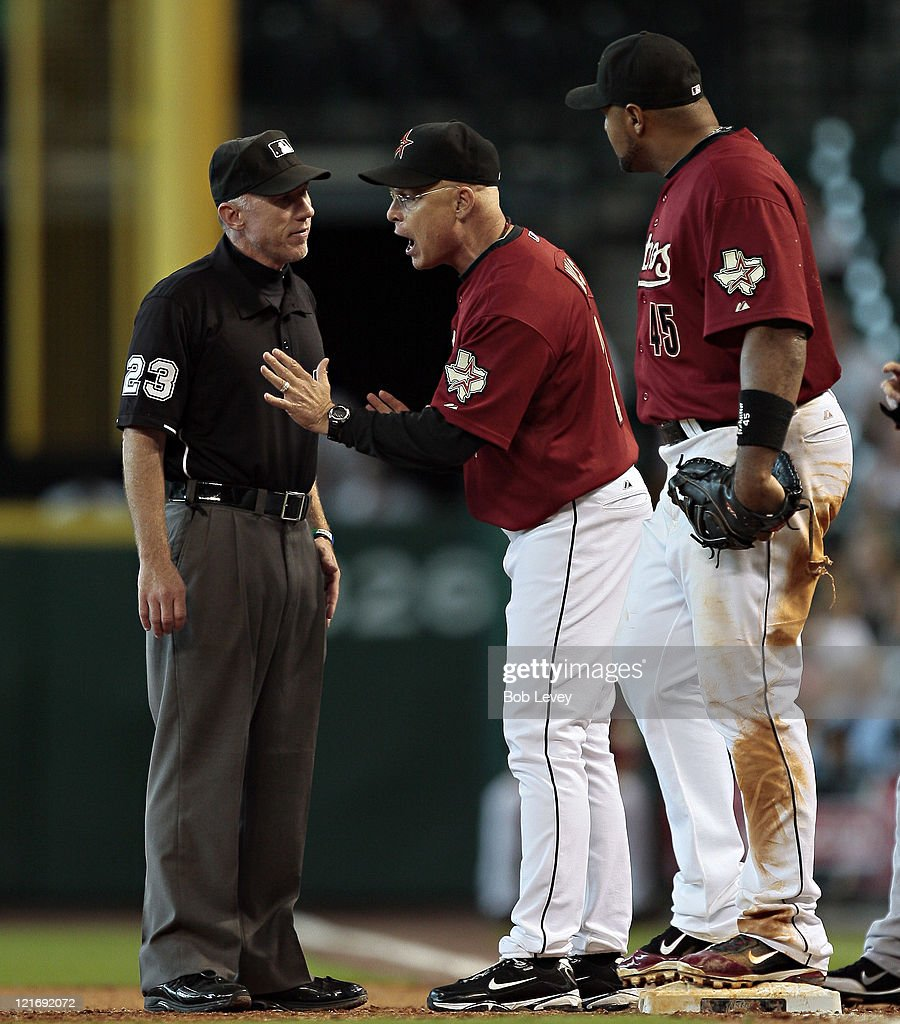 Manager Brad Mills #2 of the Houston Astros argues with first base umpire Lance Barksdale after a close play with first baseman <a gi-track='captionPersonalityLinkClicked' href=/galleries/search?phrase=Carlos+Lee&family=editorial&specificpeople=203134 ng-click='$event.stopPropagation()'>Carlos Lee</a> #45 was called safe during a baseball game against the San Francisco Giants at Minute Maid Park on August 21, 2011 in Houston, Texas.