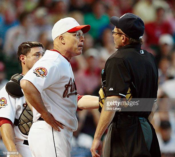 Manager Brad Mills of the Houston Astros argues with home plate umpire Bill Hohn after Hohn ejected pitcher Roy Oswalt in the third inning for...