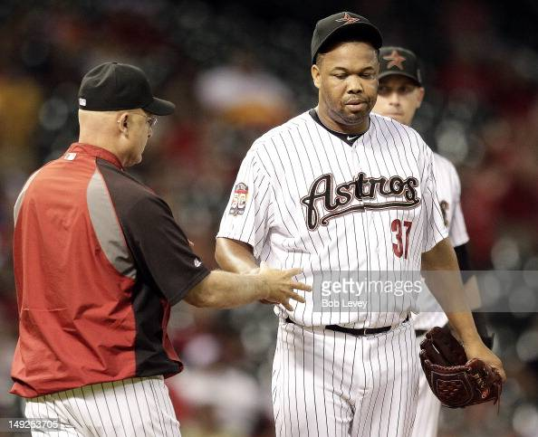 Manager Brad Mills takes the ball from Francisco Cordero of the Houston Astros as he leaves in the ninth inning against the Cincinnati Reds at Minute...