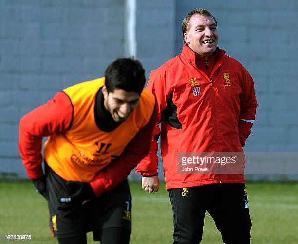Manager Brendan Rodgers of Liverpool FC shares a laugh with Luis Suarez during a training session at Melwood Training Ground on February 28 2013 in...