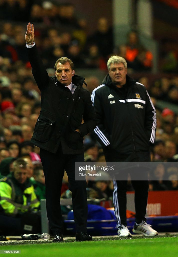 Manager Brendan Rodgers of liverpool gestures as Steve Bruce manager of Hull City looks on during the Barclays Premier League match between Liverpool and Hull City at Anfield on January 1, 2014 in Liverpool, England.