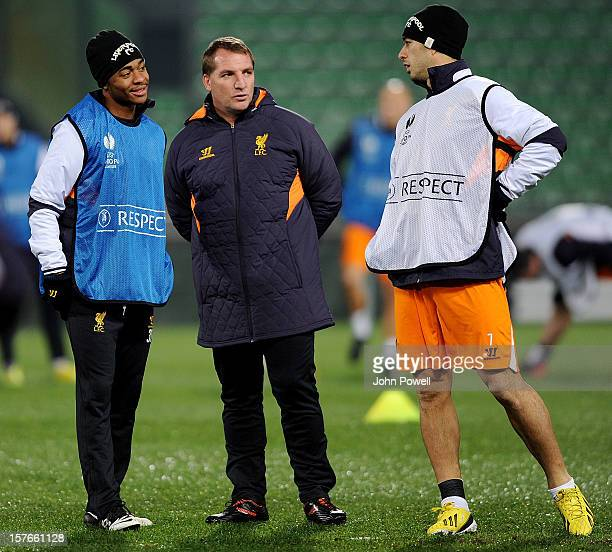 Manager Brendan Rodgers of Liverpool talking with Luis Suarez and Raheem Sterling during a training session ahead of the UEFA Europa League match...