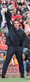 Manager Brendan Rodgers of Liverpool watches from the touchline during the Barclays Premier League match between Liverpool and Manchester United at...