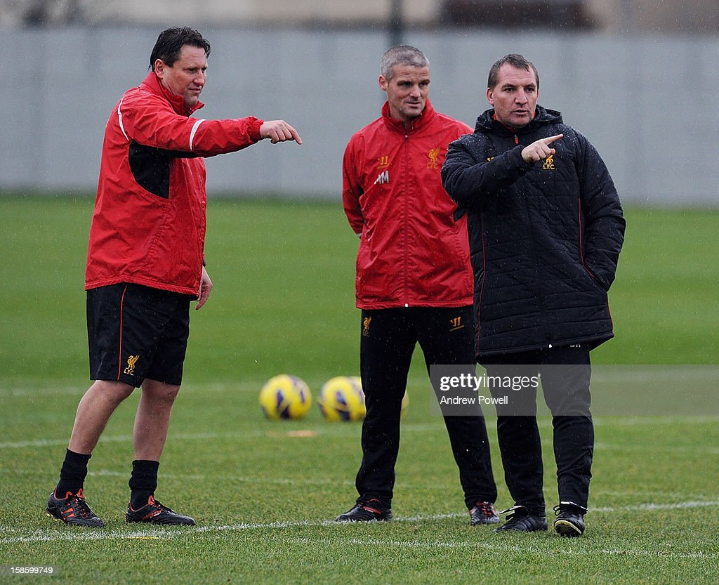 Manager <a gi-track='captionPersonalityLinkClicked' href=/galleries/search?phrase=Brendan+Rodgers+-+Soccer+Manager&family=editorial&specificpeople=5446684 ng-click='$event.stopPropagation()'>Brendan Rodgers</a> of Liverpool (R) with his assistant manager Colin Pascoe (L) and the first-tem coach Mike Marsh (C) during a training session at Melwood Training Ground on December 20, 2012 in Liverpool, England.