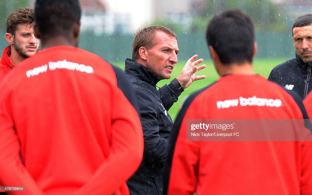 Manager Brendan Rodgers talks to the Liverpool players as they return for pre-season training at Melwood Training Ground on July 6, 2015 in Liverpool, England.