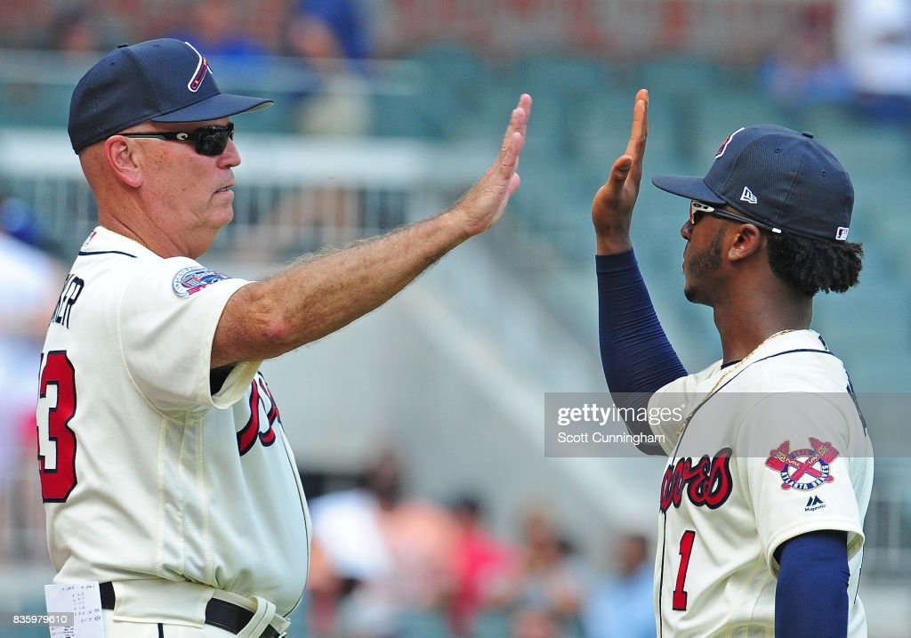 Manager Brian Snitker #43 and Ozzie Albies #1 of the Atlanta Braves celebrate after the game against the Cincinnati Reds at SunTrust Park on August 20, 2017 in Atlanta, Georgia.