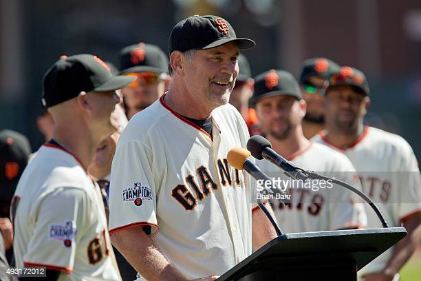 Manager Bruce Bochy introduces pitcher Tim Hudson of the San Francisco Giants dueing a ceremony to honor his retirement before a game against the...