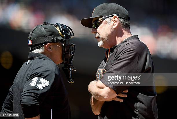 Manager Bruce Bochy of the San Francisco Giants argues with home plate umpire John Hirschbeck over a strike call on Angel Pagan in the bottom of the...