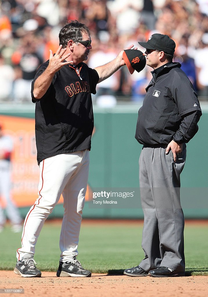 Manager <a gi-track='captionPersonalityLinkClicked' href=/galleries/search?phrase=Bruce+Bochy&family=editorial&specificpeople=220291 ng-click='$event.stopPropagation()'>Bruce Bochy</a> #16 of the San Francisco Giants argues with umpire Dan Bellino #93 during a game between the Houston Astros and the San Francisco Giants at AT&T Park on August 28, 2011 in San Francisco, California.