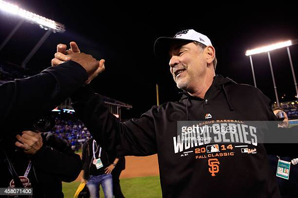 Manager Bruce Bochy of the San Francisco Giants celebrates on the field after defeating the Kansas City Royals 32 to win Game Seven of the 2014 World...