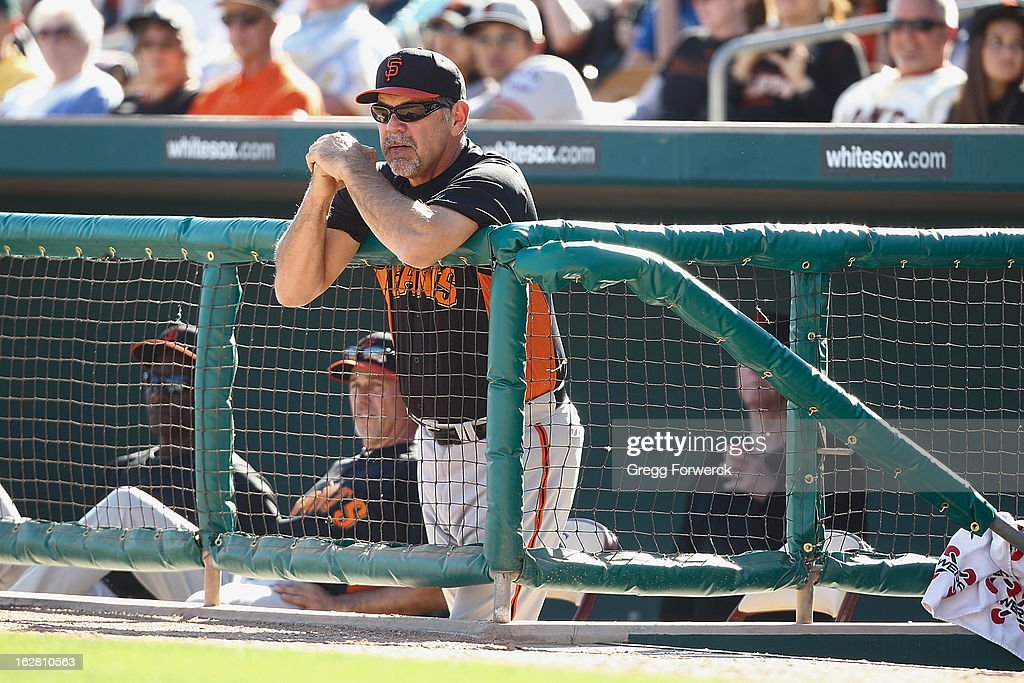 Manager <a gi-track='captionPersonalityLinkClicked' href=/galleries/search?phrase=Bruce+Bochy&family=editorial&specificpeople=220291 ng-click='$event.stopPropagation()'>Bruce Bochy</a> of the San Francisco Giants coaches from the corner of the dugout during a spring training baseball game against the Los Angeles Dodgers at Camelback Ranch on February 26, 2013 in Glendale, Arizona.