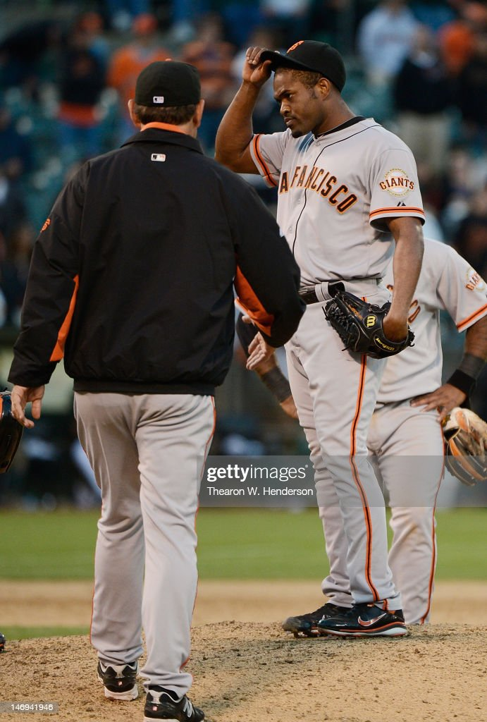 Manager <a gi-track='captionPersonalityLinkClicked' href=/galleries/search?phrase=Bruce+Bochy&family=editorial&specificpeople=220291 ng-click='$event.stopPropagation()'>Bruce Bochy</a> #15 of the San Francisco Giants comes to the mound to take <a gi-track='captionPersonalityLinkClicked' href=/galleries/search?phrase=Santiago+Casilla&family=editorial&specificpeople=682637 ng-click='$event.stopPropagation()'>Santiago Casilla</a> #46 out of the game in the ninth inning against the Oakland Athletics at O.co Coliseum on June 23, 2012 in Oakland, California.