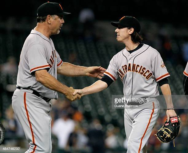 Manager Bruce Bochy of the San Francisco Giants congratulates pitcher Tim Lincecum after a 82 win over the Detroit Tigers at Comerica Park on...