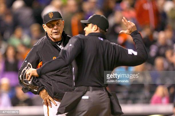Manager Bruce Bochy of the San Francisco Giants gets ejected from the game by home plate umpire John Tumpane for arguing balls and strikes during the...
