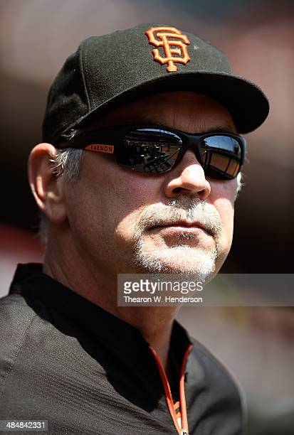 Manager Bruce Bochy of the San Francisco Giants looks on from the dugout prior to the start of their game against the Colorado Rockies at ATT Park on...