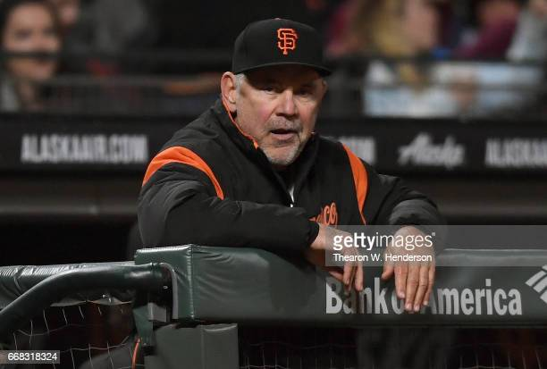 Manager Bruce Bochy of the San Francisco Giants looks on from the dugout against the Colorado Rockies in the bottom of the seventh inning at ATT Park...