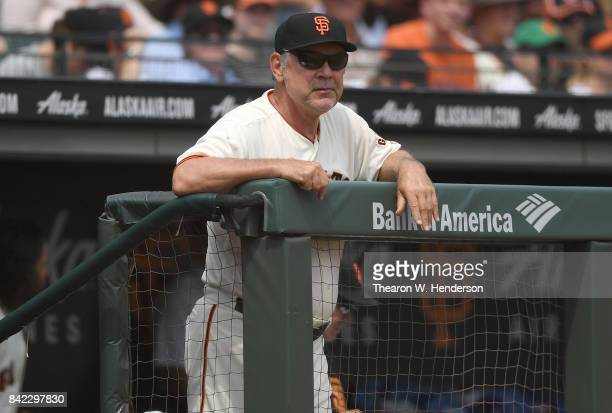 Manager Bruce Bochy of the San Francisco Giants looks on from the dugout against the St Louis Cardinals in the bottom of the third inning at ATT Park...