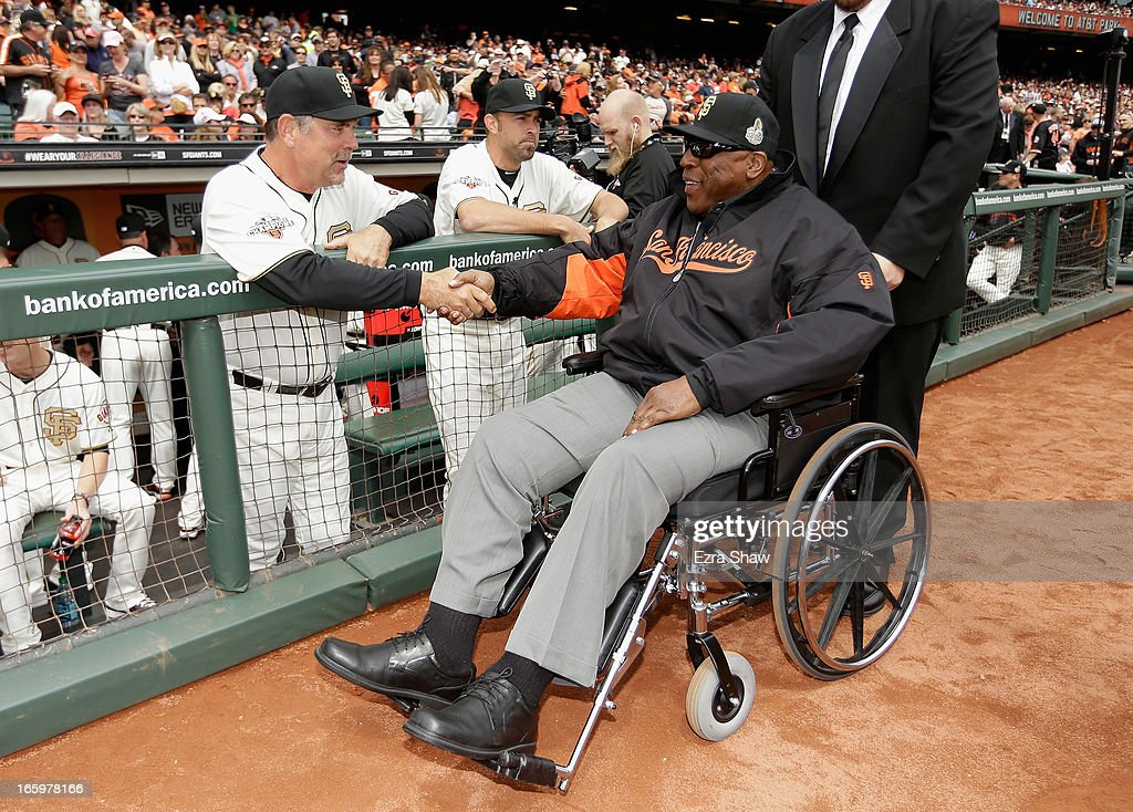 Manager Bruce Bochy #15 of the San Francisco Giants shakes hands with Hall of Famer Willie McCovey before a pregame ceremony honoring the 2012 World Series champions before their game against the St. Louis Cardinals at AT&T Park on April 7, 2013 in San Francisco, California.