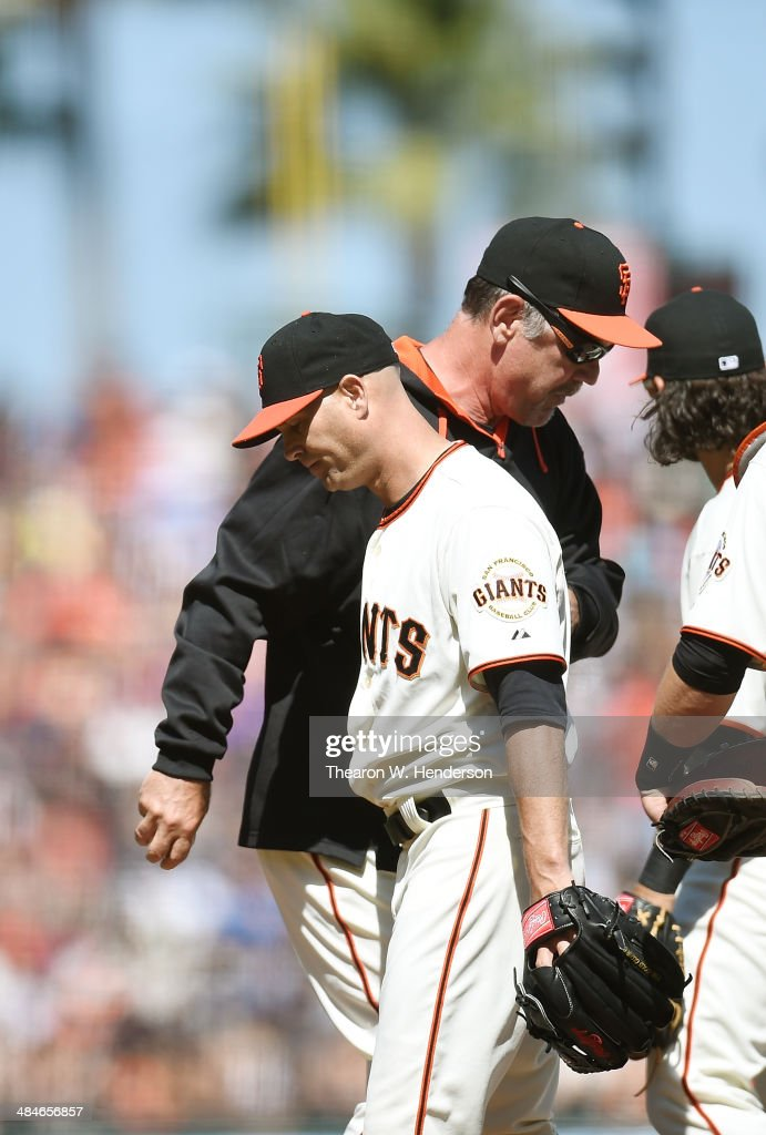 Manager Bruce Bochy #15 of the San Francisco Giants takes pitcher Tim Hudson #17 out of the game against the Colorado Rockies in the eighth inning at AT&T Park on April 13, 2014 in San Francisco, California.