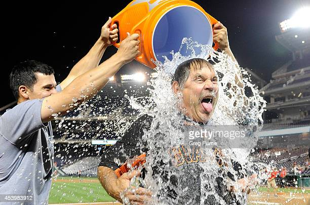 Manager Bruce Bochy of the San Francisco Giants takes the ALS Ice Bucket Challenge after the game against the Washington Nationals at Nationals Park...