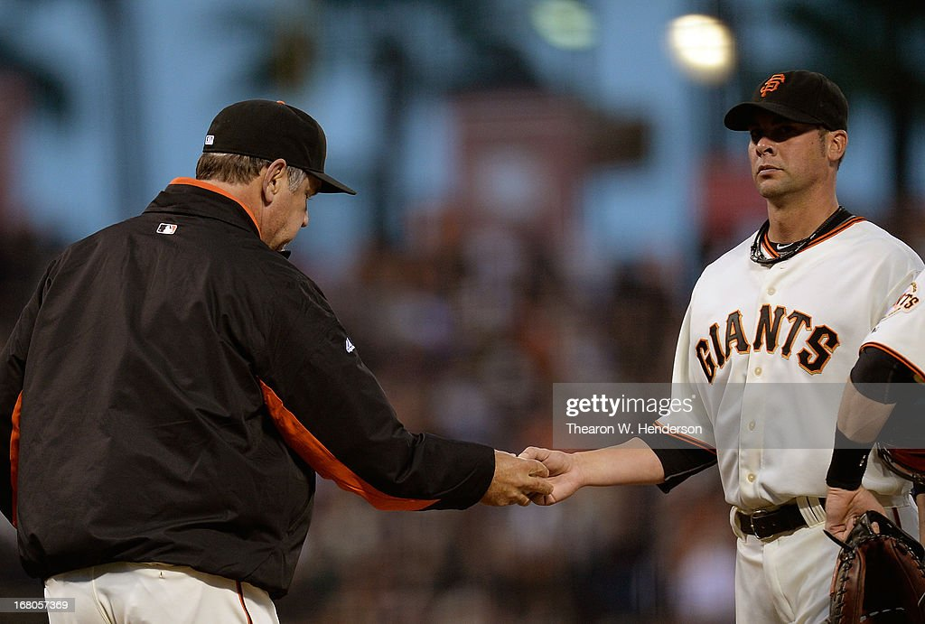 Manager <a gi-track='captionPersonalityLinkClicked' href=/galleries/search?phrase=Bruce+Bochy&family=editorial&specificpeople=220291 ng-click='$event.stopPropagation()'>Bruce Bochy</a> #15 of the San Francisco Giants takes the ball from pitcher <a gi-track='captionPersonalityLinkClicked' href=/galleries/search?phrase=Ryan+Vogelsong&family=editorial&specificpeople=670011 ng-click='$event.stopPropagation()'>Ryan Vogelsong</a> #32 taking him out of the game against the Los Angeles Dodgers in the fifth inning at AT&T Park on May 4, 2013 in San Francisco, California.