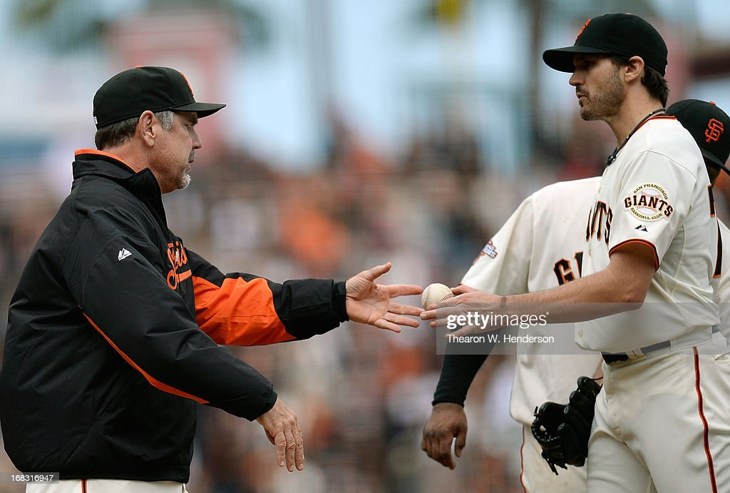 Manager <a gi-track='captionPersonalityLinkClicked' href=/galleries/search?phrase=Bruce+Bochy&family=editorial&specificpeople=220291 ng-click='$event.stopPropagation()'>Bruce Bochy</a> #15 of the San Francisco Giants takes the ball from pitcher <a gi-track='captionPersonalityLinkClicked' href=/galleries/search?phrase=Barry+Zito&family=editorial&specificpeople=202943 ng-click='$event.stopPropagation()'>Barry Zito</a> #75, taking Zito out of the game, against the Philadelphia Phillies in the eighth inning at AT&T Park on May 8, 2013 in San Francisco, California.