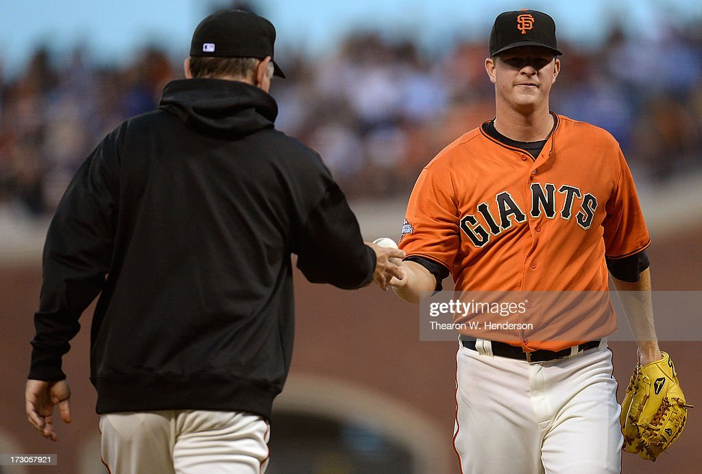Manager Bruce Bochy #15 (L) of the San Francisco Giants takes the ball from pitcher Matt Cain #18 (R) taking Cain out of the game in the third inning against the Los Angeles Dodgers at AT&T Park on July 5, 2013 in San Francisco, California.