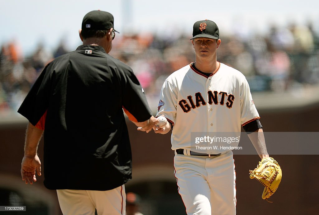 Manager <a gi-track='captionPersonalityLinkClicked' href=/galleries/search?phrase=Bruce+Bochy&family=editorial&specificpeople=220291 ng-click='$event.stopPropagation()'>Bruce Bochy</a> #15 of the San Francisco Giants takes the ball from pitcher <a gi-track='captionPersonalityLinkClicked' href=/galleries/search?phrase=Matt+Cain&family=editorial&specificpeople=534602 ng-click='$event.stopPropagation()'>Matt Cain</a> taking him out of the game in the first inning against the New York Mets at AT&T Park on July 10, 2013 in San Francisco, California. Cain only pitched two thirds of an inning.