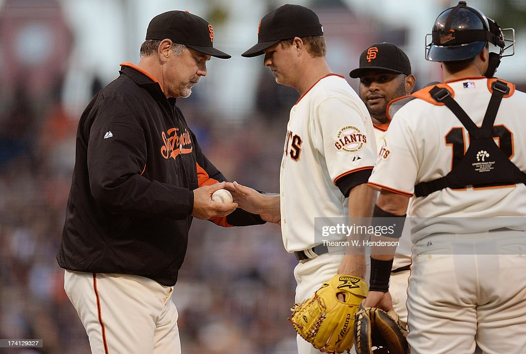 Manager <a gi-track='captionPersonalityLinkClicked' href=/galleries/search?phrase=Bruce+Bochy&family=editorial&specificpeople=220291 ng-click='$event.stopPropagation()'>Bruce Bochy</a> #15 of the San Francisco Giants takes the ball from pitcher <a gi-track='captionPersonalityLinkClicked' href=/galleries/search?phrase=Matt+Cain&family=editorial&specificpeople=534602 ng-click='$event.stopPropagation()'>Matt Cain</a> #18 taking him out of the game in the sixth inning against the Arizona Diamondbacks at AT&T Park on July 20, 2013 in San Francisco, California.
