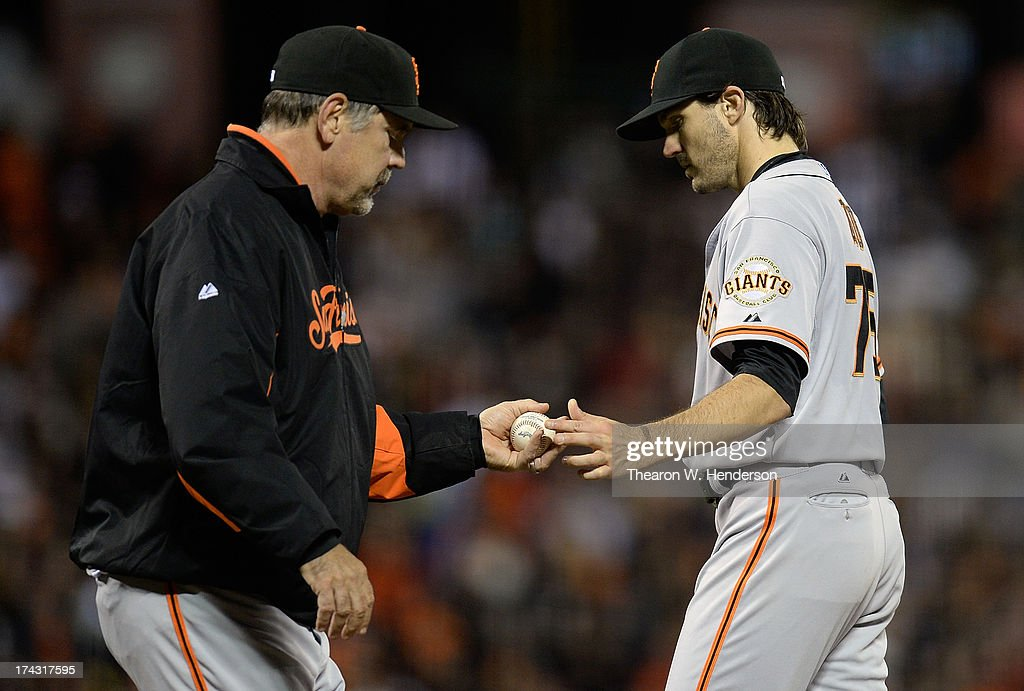 Manager <a gi-track='captionPersonalityLinkClicked' href=/galleries/search?phrase=Bruce+Bochy&family=editorial&specificpeople=220291 ng-click='$event.stopPropagation()'>Bruce Bochy</a> #15 of the San Francisco Giants takes the ball from pitcher <a gi-track='captionPersonalityLinkClicked' href=/galleries/search?phrase=Barry+Zito&family=editorial&specificpeople=202943 ng-click='$event.stopPropagation()'>Barry Zito</a> #75 taking him out of the game in the fifth inning against the Cincinnati Reds at AT&T Park on July 23, 2013 in San Francisco, California.